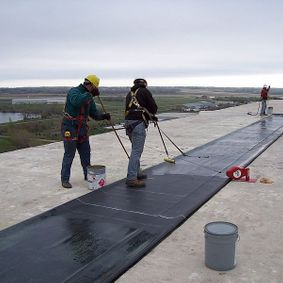 Employees working on a flat top roof