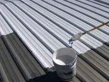 Metal top coat on a roof