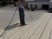 Power washing a flat top roof